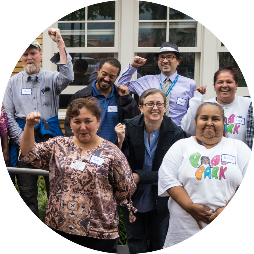 Group of happy people with hands in the air from the Urban Greening program in Richmond, California